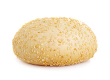 Round bun with sesame seeds on a white background Stock Photography