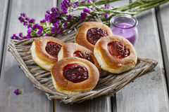 Round buns with plum on wooden table Stock Photography