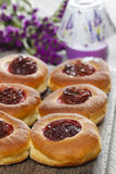 Round buns with plum on wooden table Royalty Free Stock Image