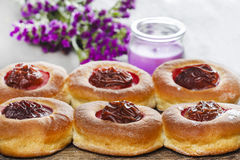 Round buns with plum on wooden table Stock Image