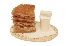 Round burek with yoghurt. Breakfast option isolated on white background Royalty Free Stock Photography