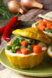 Round bush pumpkins baked with vegetables vertical Royalty Free Stock Photography