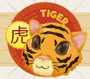 Cute Head of a Tiger with Label for Chinese Zodiac, Vector Illustration. Round button with pattern and a cute head of a tiger of Chinese Zodiac -written in Stock Photos