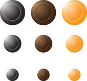Round buttons of different colors and sizes. Round button black, brown and yellow colors of different sizes on a white background Stock Photos