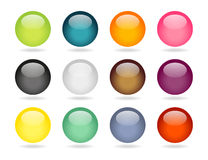 12 round buttons set. Set of 12 colorful sphere buttons with light shadow Royalty Free Stock Images