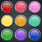 Round buttons with water drops Stock Images