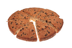 Round cake. Image of a sliced round cake with chocolate isolated against a white background Stock Photography
