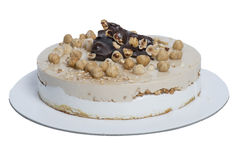 Round cake with chocolate, hazelnut, vanilla and cocoa, cropped. In still life Stock Images
