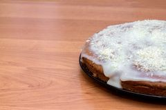 Round cake with custard sprinkle with coconut chips stock images