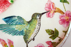 Round cake with fondant and painted humming-bird. And flowers royalty free stock image