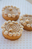 Round cakes with caramel and nuts Stock Photo