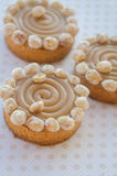 Round cakes with caramel and nuts Royalty Free Stock Image