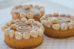 Round cakes with caramel and nuts Stock Photos