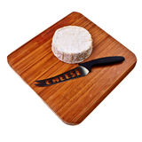Round camembert block on wooden board. Royalty Free Stock Image