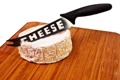 Round camembert block on wooden board. Royalty Free Stock Images