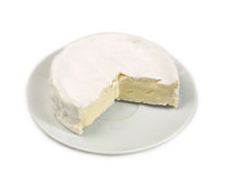 Round camembert cheese with a cut out piece Royalty Free Stock Image