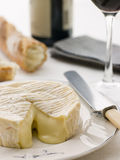 Round of camembert cheese with French stick Royalty Free Stock Photography