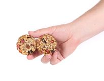 Round candied seeds and nuts in hand. royalty free stock photo