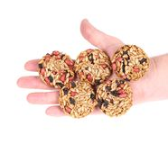 Round candied seeds and nuts in hand. Royalty Free Stock Images