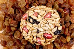 Round candied seeds and nuts with raisins. Stock Image