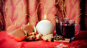 Round candle, balls, cookies, mulled wine and spices Stock Photography