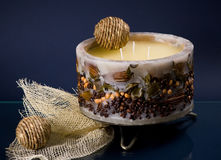 Round candle with coffee beans on blue Royalty Free Stock Images