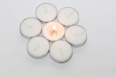 Round Candle lights arranged. Round Tea Candle lights arranged in round shape with center candle lit. Christmas lighting Royalty Free Stock Photo