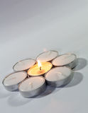 Round Candle lights arranged. Round Tea Candle lights arranged in round shape with center candle lit. Christmas lighting Stock Images