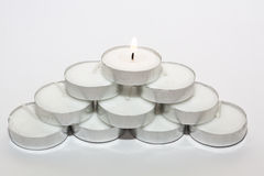 Round Candle lights arranged. Round Tea Candle lights arranged in triangle. Christmas lighting Stock Photos