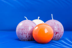Round candles. Beautiful colorful  candles on a Blue background Stock Photo