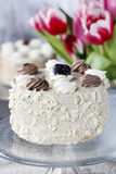 Round cappuccino cake on cake stand Stock Photo