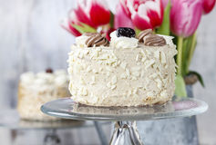 Round cappuccino cake on cake stand Stock Photos