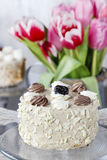 Round cappuccino cake on cake stand Royalty Free Stock Image