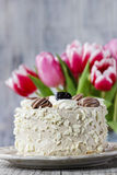 Round cappuccino cake on cake stand Stock Photography