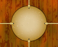 Round cardboard frame on the ropes Royalty Free Stock Images