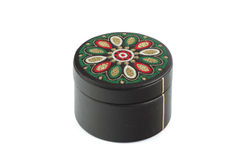 The round casket fitted by a black skin. The round casket fitted by a black skin and decorated with an embroidery in traditional east style Royalty Free Stock Image
