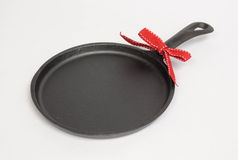 Round Cast Iron Skillet with Red Bow Royalty Free Stock Photos