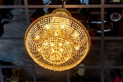 Round ceiling lamp ,Modern hanging lighting fixtures.Decorative round chandelier in dining room at home .Interior design. Electrical lamps hanging on the royalty free stock image