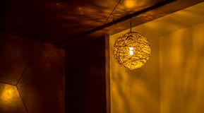 Round Ceiling Light. Illuminated Round Ceiling Light in the corner of a room royalty free stock photography