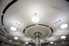 Round ceiling with modern white ceiling lights. In a restaurant royalty free stock photography