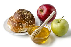 Round challah, apples and a bowl of honey Royalty Free Stock Photo