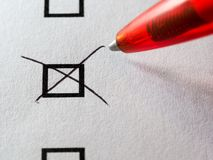 List of checkboxes. Round Checkboxes and red pen ballpoint marking one box on white background Stock Photos