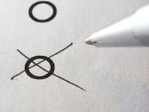 List of checkboxes. Round Checkboxes and silver pen ballpoint marking one box on white background Stock Photography