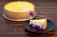 Round cheese cake with piece stock images