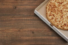 Round Cheese Pie Or Quatrro Formaggi Pizza On Brown Table Royalty Free Stock Photos
