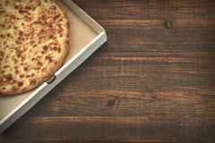 Round Cheese Pie Or Quatrro Formaggi Pizza On Brown Table Stock Photos