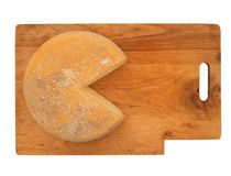 Round cheese on rustic wooden board, isolated over white Stock Photography