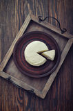 Round cheese on vintage tray Royalty Free Stock Photo