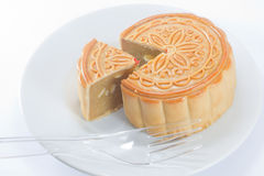The round Chinese moon cake on dish Royalty Free Stock Photography