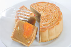 The round Chinese moon cake on dish Stock Image